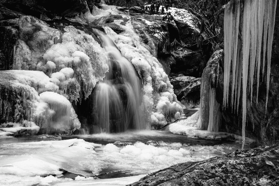 winter canvas print of frozen waterfalls creating an ice cave