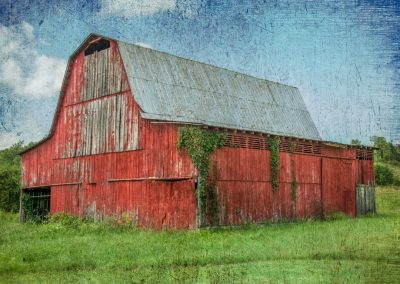 barn art prints with red faded barn blue sky and green grass