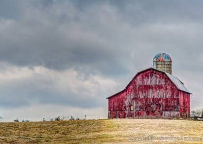 barn and silo in brown field image for ijams nature center