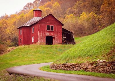 secluded red barn in autumn setting photo for ijams nature center