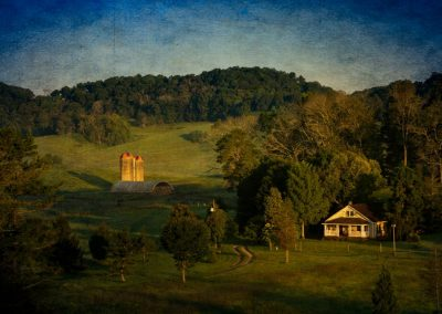 farmhouse with barn and silos in rolling terrain for ijams nature center photo exhibit
