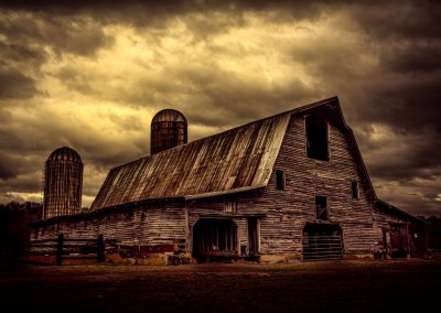 dark stormy sky over old rustic barn