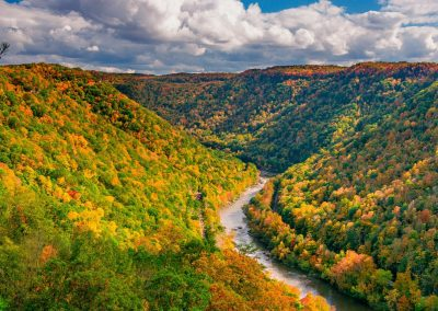 landscape art print of river gorge cutting through fall colored mountains