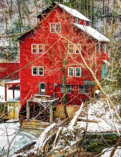 winter wall art old red mill in snowy scene
